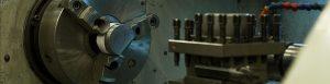 Large metal cylinder door on machinery.