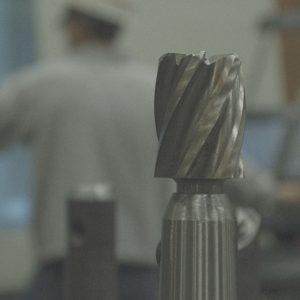 Close up of a drill bit head.