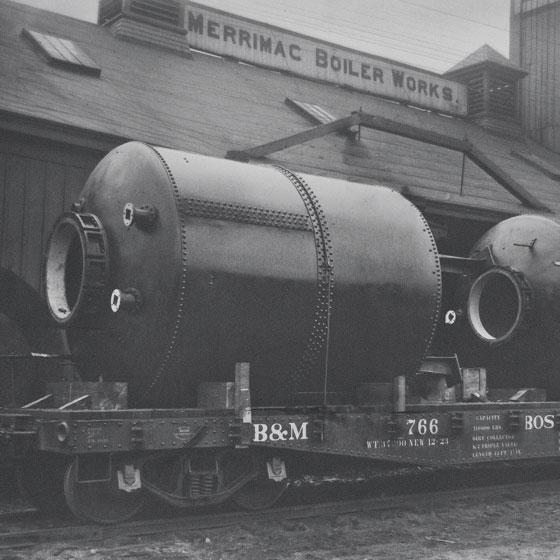 Historical shot of old train outside Merrimac Boiler Works ...