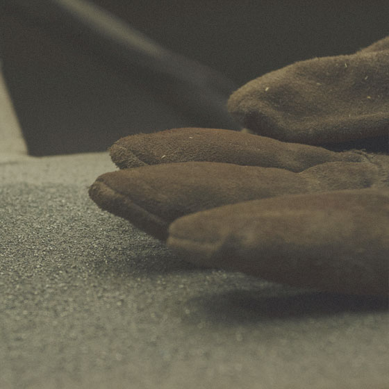 Workers' battered gloves in the shop.