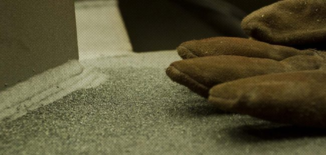 detail of glove and sandblasting dust